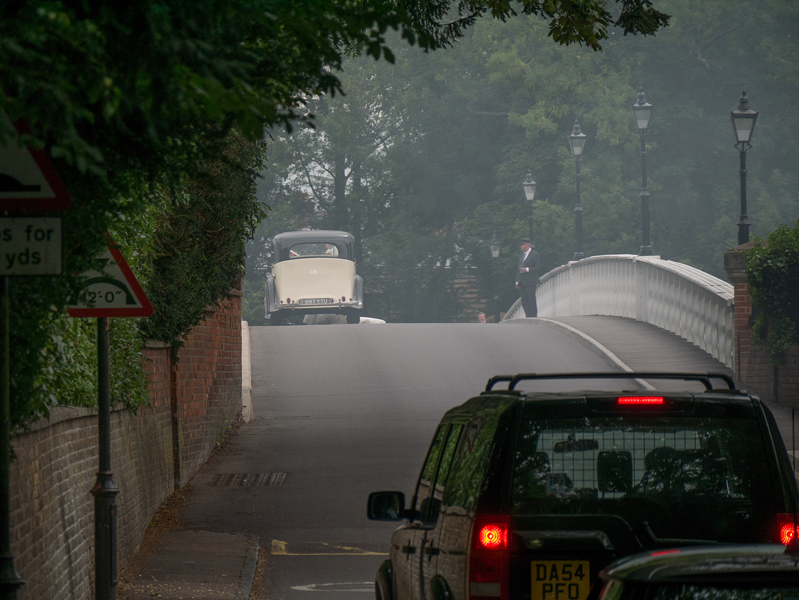 Wedding car on the bridge at Pangbourne amidst nearby bonfire smoke