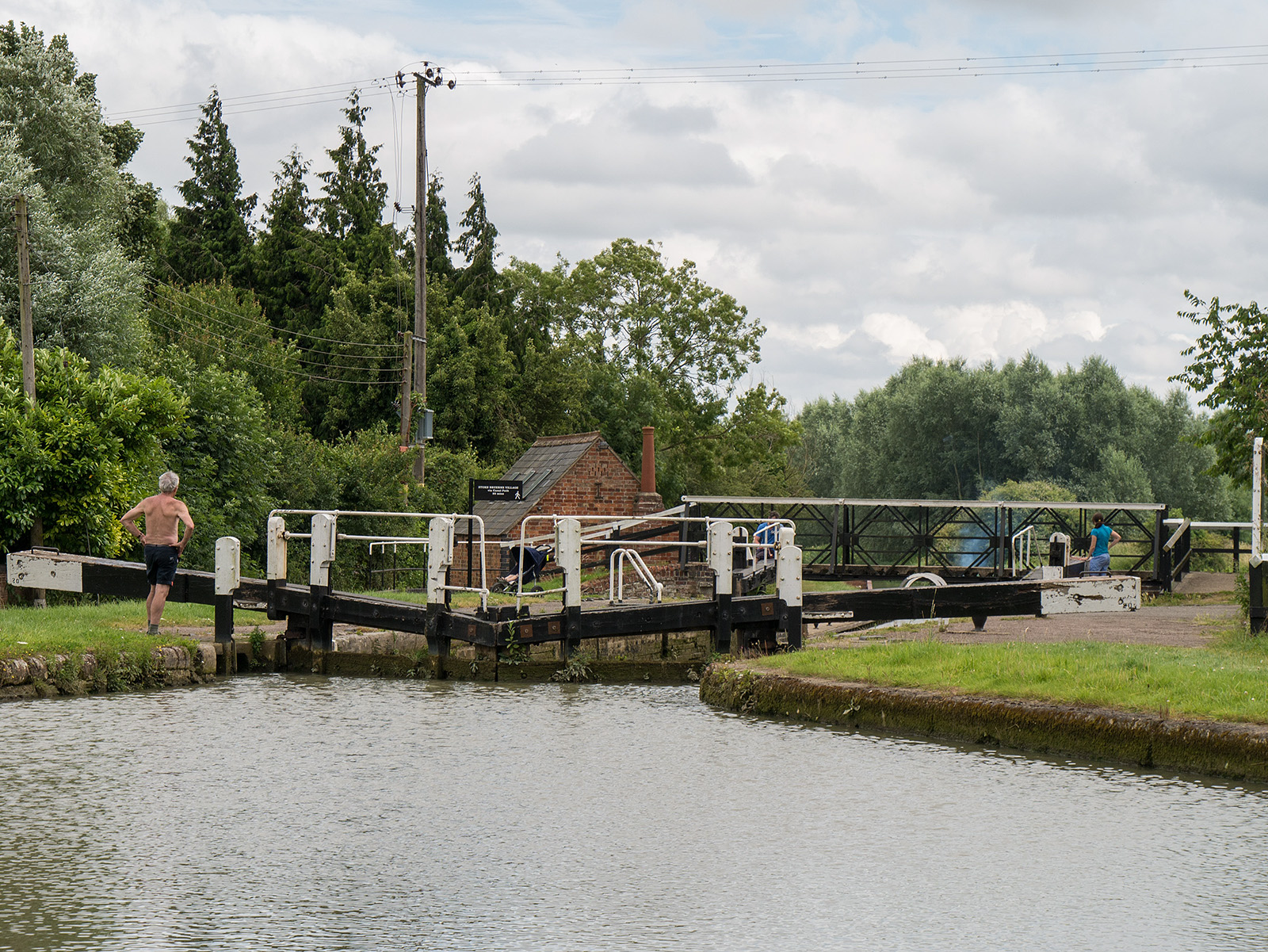 Top gates closed, bottoms open, boat entering the bottom of the Stoke Bruerne flight