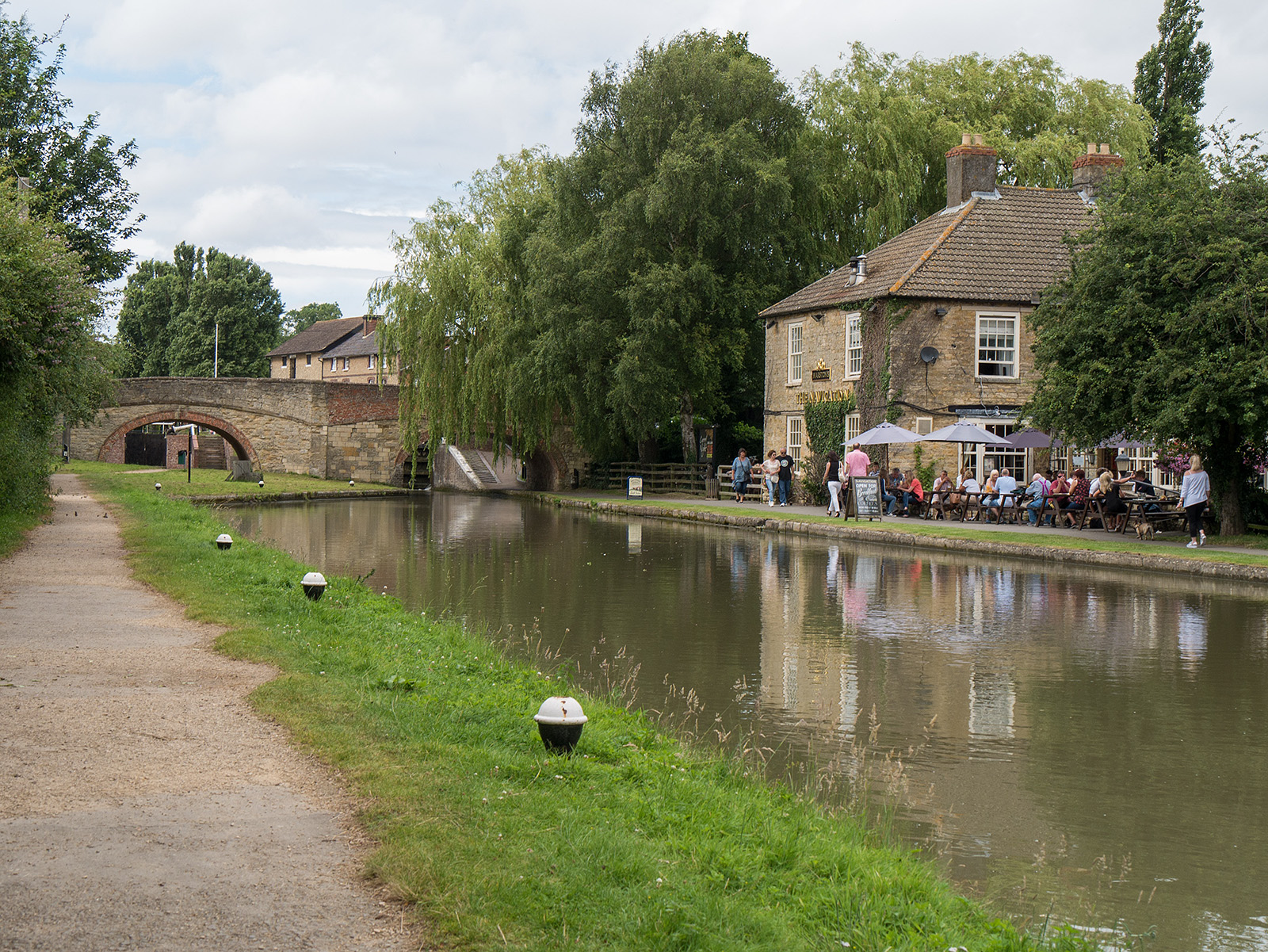 Approaching the Navigation pub. Note the wider canal and the double bridge but only one lock (RHS)