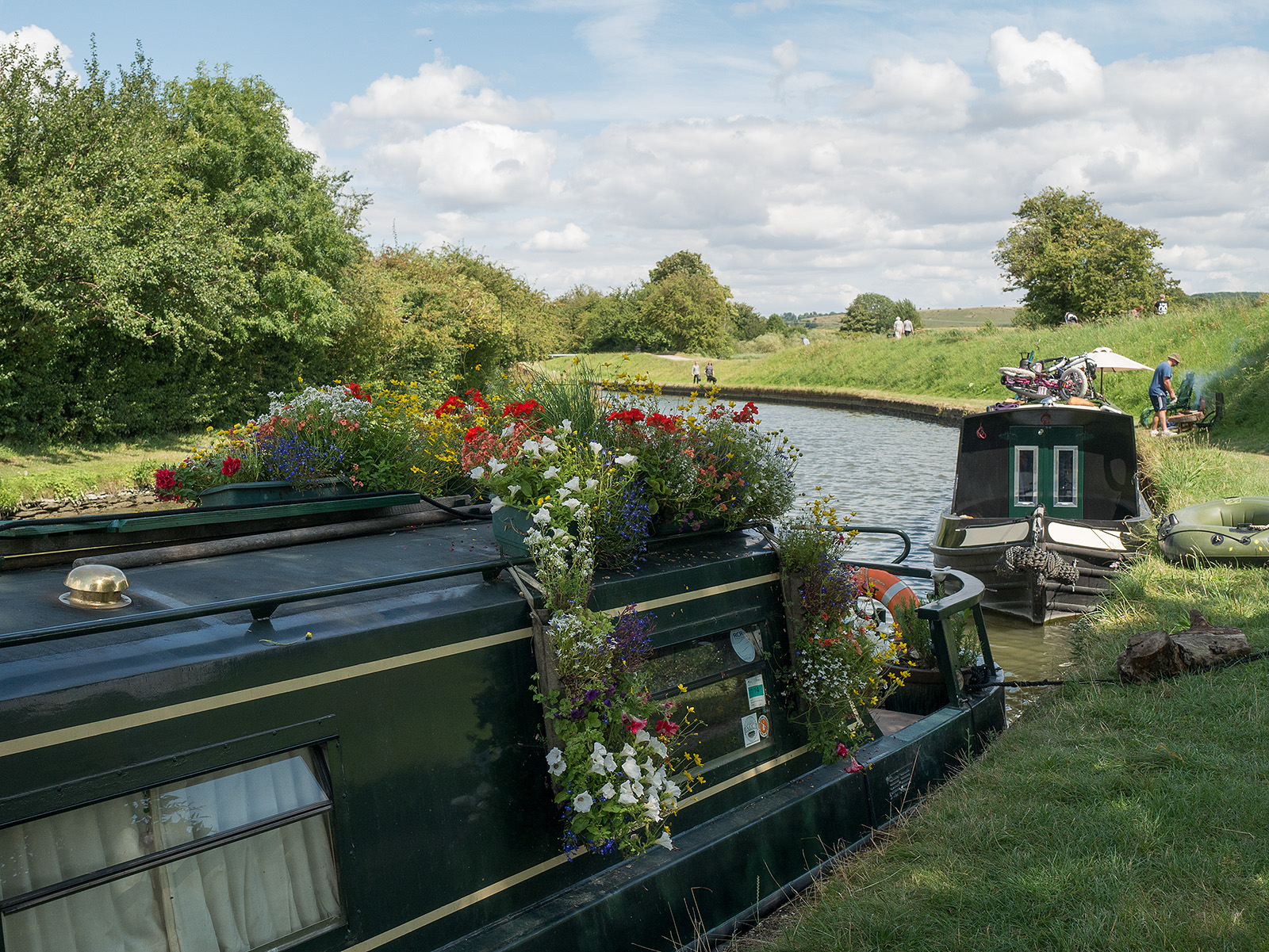 Attractive flowers atop a boat on the canal as it winds its way down the slope north of Marsworth