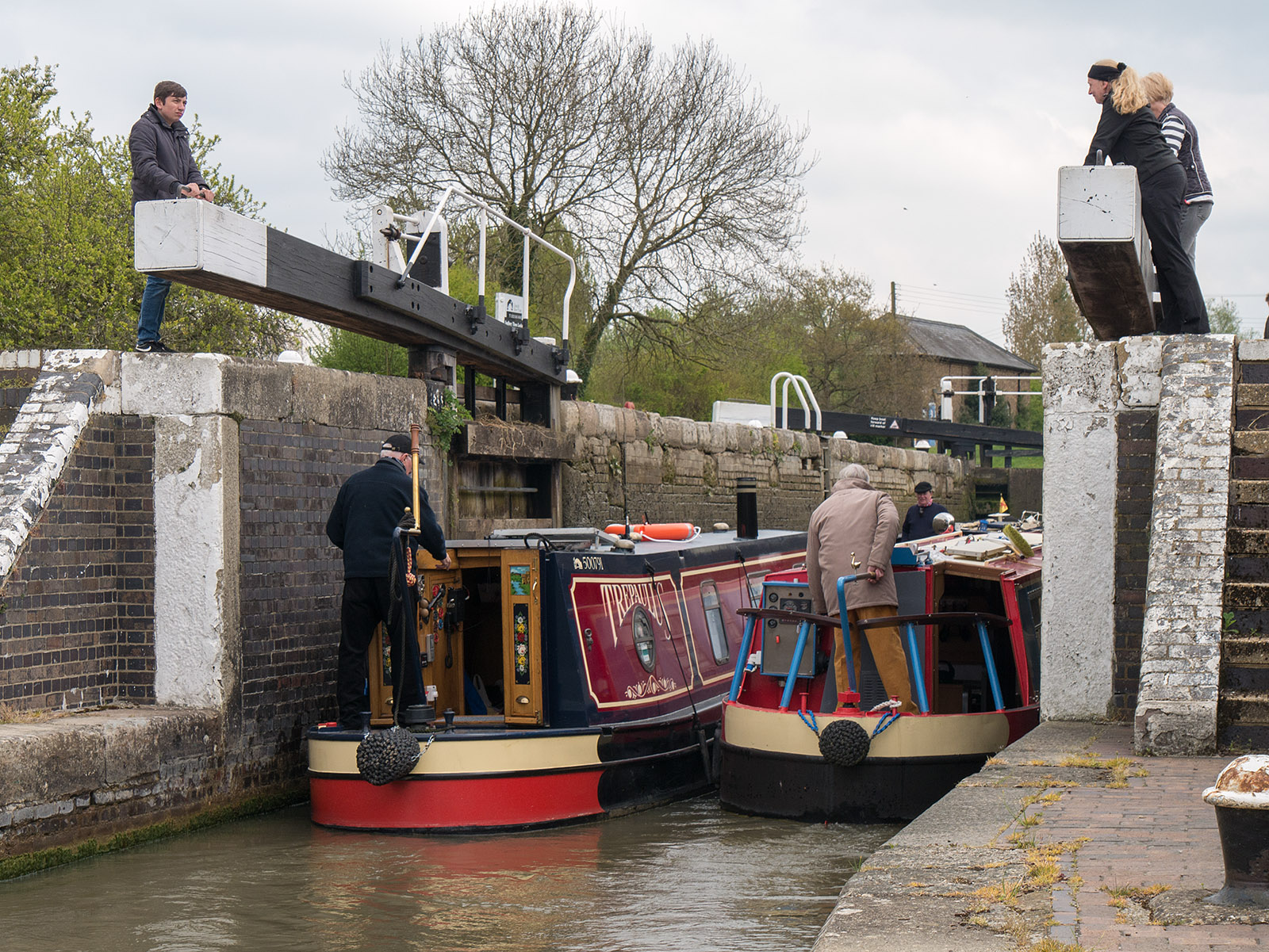 About to close the lower lock gates on the lowest lock, three boats inside going up the locks