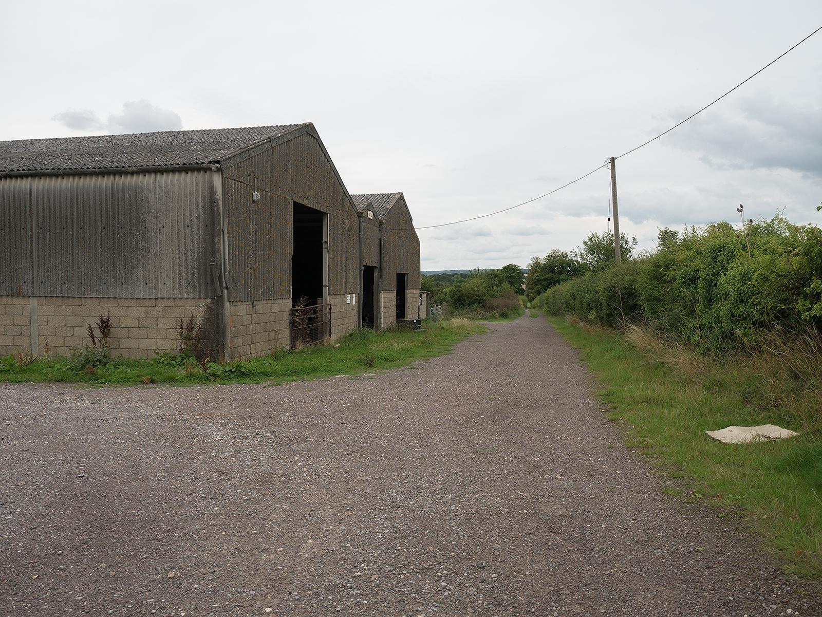 Passing beside Cranford Barn, back down towards the river