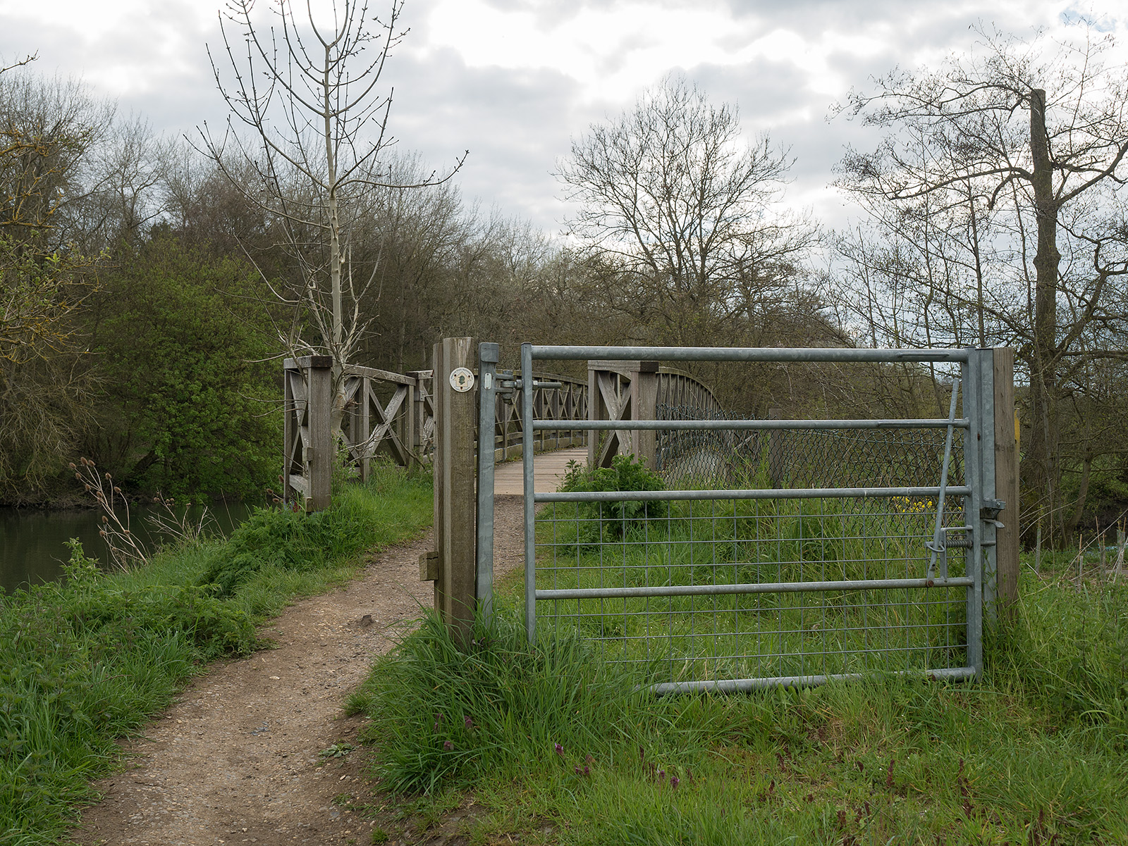 Errm, not really a useful gate any more! Approach to wooden bridge at Dorchester.