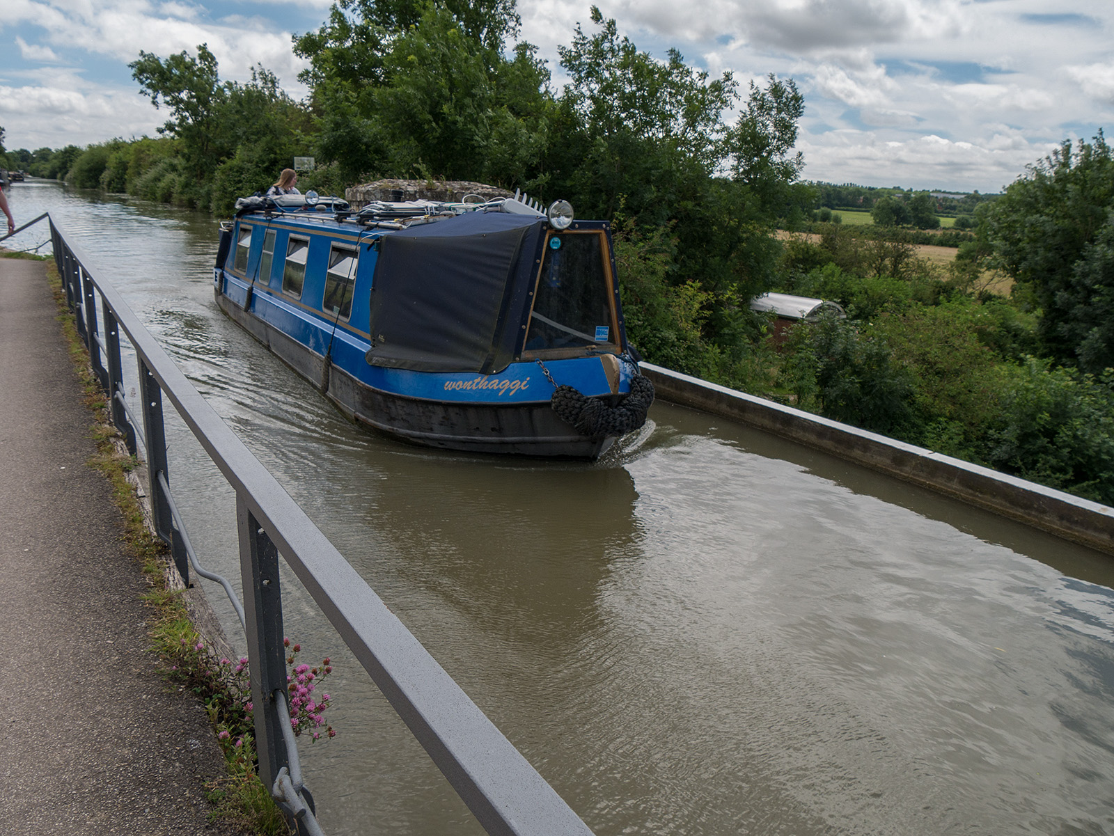 Boat crossing the iron duct aqueduct